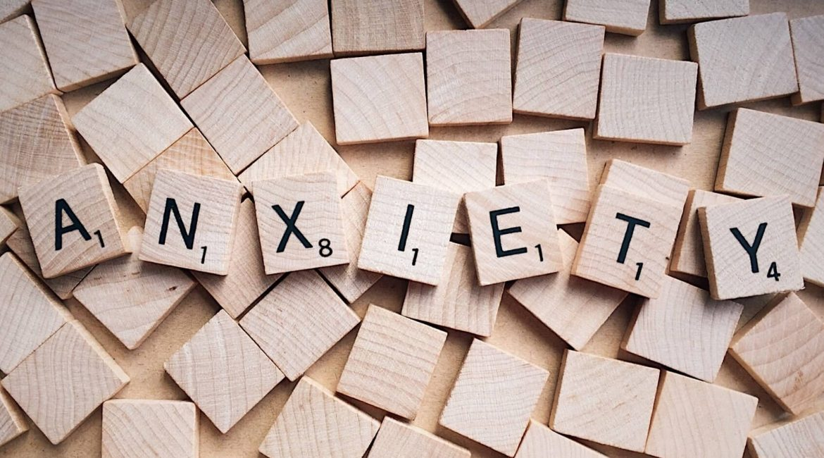 """alt=""""A picture of wooden tiles spelling the word anxiety"""""""