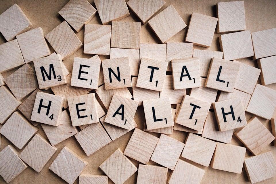 "alt="" Blocks of wooden tiles that spell out mental health(fitness)."""