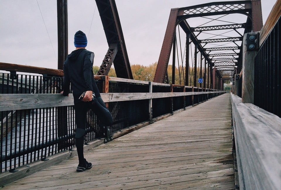 """alt=""""man in black sport wear about to begin a jog to improve his fitness levels."""""""